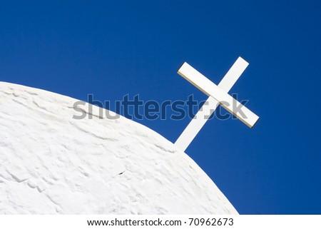 white cross on a greek church - stock photo