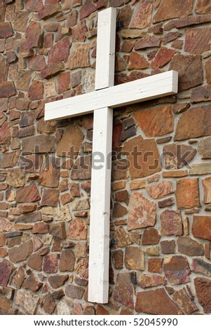 White cross on wall - stock photo