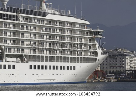 White cruise ship anchored in port - stock photo