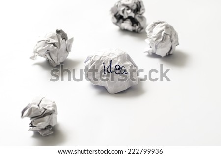 white crumpled paper ball focus idea word on a white background - stock photo
