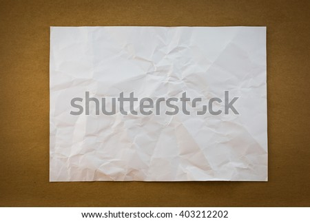 White crumpled paper on wood paper background texture vintage style with vignette