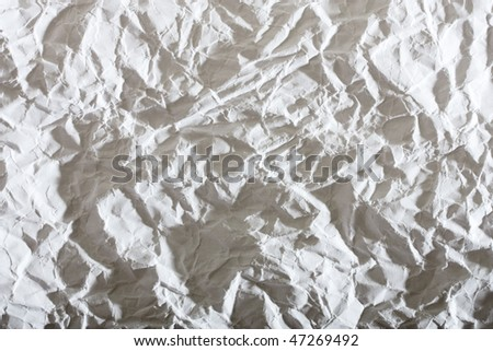 white crumpled paper, with sharp shadows - stock photo