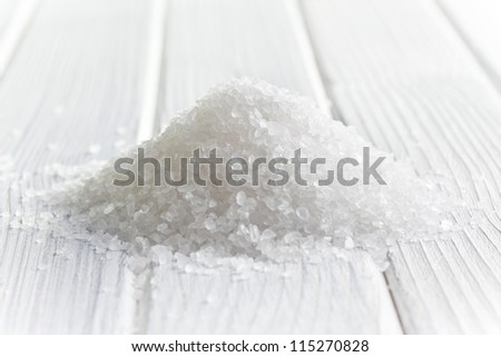 white crystal salt on wooden table