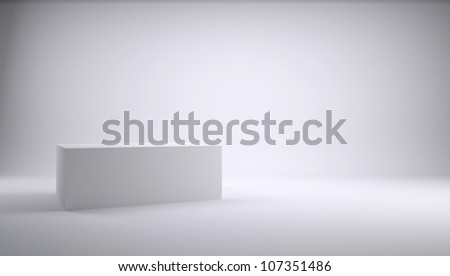 White cube in the studio. White background - stock photo