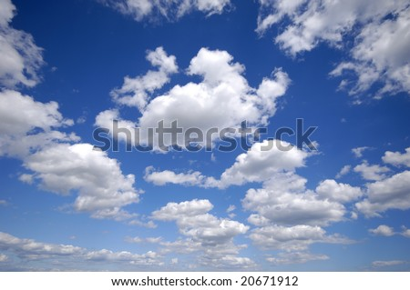 White cumulus clouds and a blue sky. - stock photo