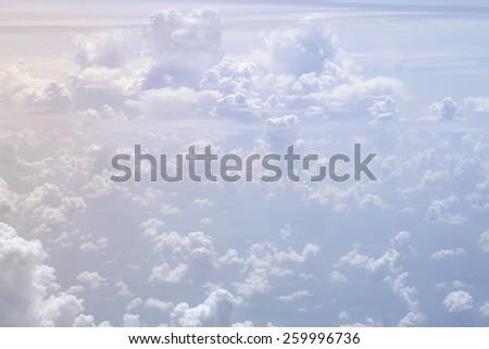 White cumulus clouds far below. - stock photo