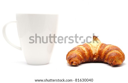 White cup and a croissant, isolated on a white background - stock photo