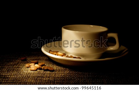 white cup and coffee beans - stock photo