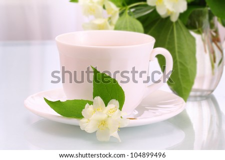 White cup and jasmine flowers