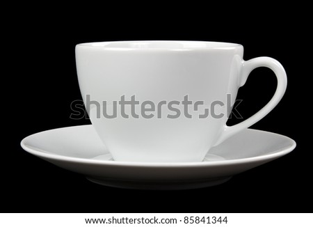 white cup and saucer isolated on black background