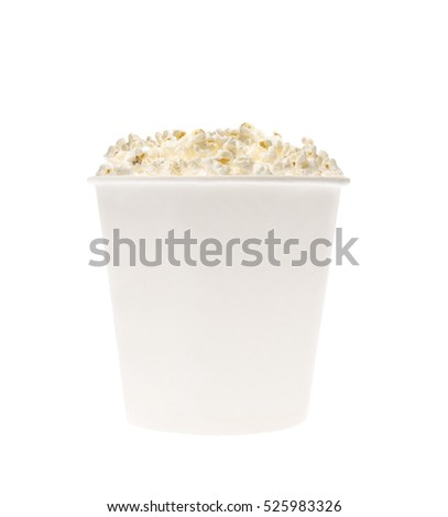 White cup filled with popcorn isolated on white