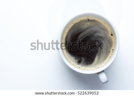 white cup of black coffee shot overhead