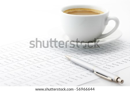 White cup of cappuccino and silver pen on paper table numbers. - stock photo