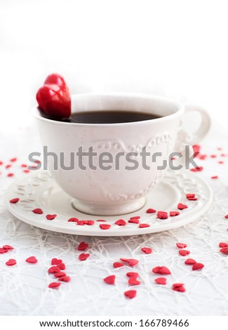 White cup of coffee decorated with red heart, Valentine concept