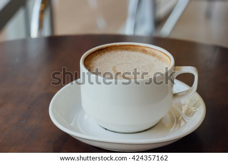 white cup of coffee in vintage tone style