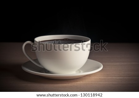 white cup of coffee on black background - stock photo