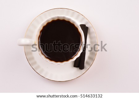 White cup of dark coffee on white background