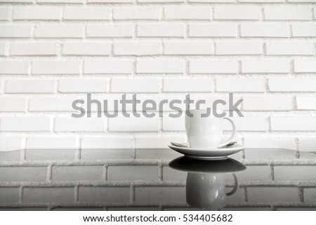 Delicieux White Cup Of Hot Coffee On Top Of Glass Table With White Brick Wall  Background.