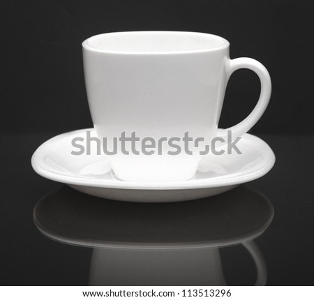 white cup on black