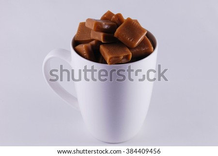 white cup with sweet caramel