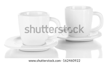 White cups isolated on white - stock photo