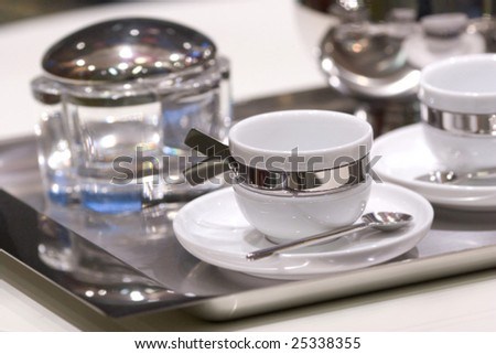 White Cups on a metal Tray and other Utensils