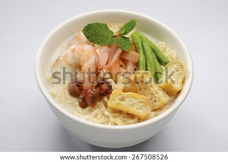 white curry noodle on the white background - stock photo