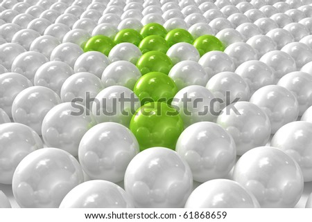 White 3D balls with green ones forming an arrow - stock photo