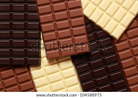 White, dark and milk chocolate in a stack