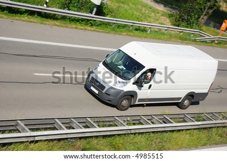 white delivery truck, slight motion blur - stock photo