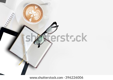 White desk with office supplies and cup of coffee, top view - stock photo