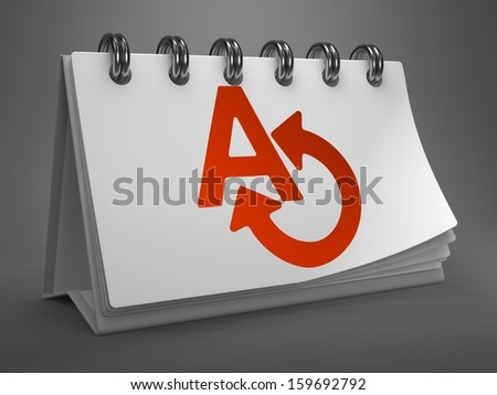 White Desktop Calendar with Red Translate Icon on Gray Background. Communication Concept. - stock photo