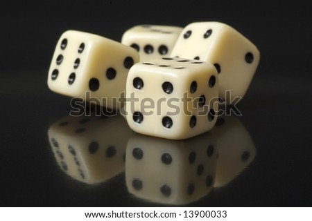 white dice on a black background - stock photo