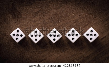 White dice on wooden background. All number five. Concept of luck, chance and leisure fun. - stock photo