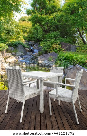 White dining table on  wooden floor and waterfall background