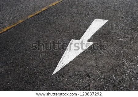 White Directional Arrow on Asphalt - stock photo