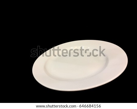White dish and the Black background.