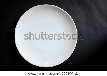 white dish plate empty isolated on black background and space for text