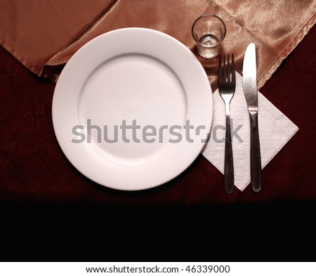 White dish with fork and knife - stock photo