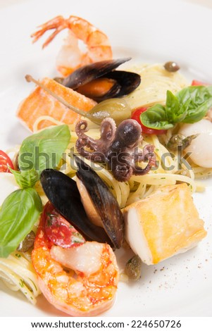 White dish with pasta and sea food - stock photo