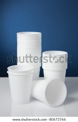 White disposable plastic cups - stock photo