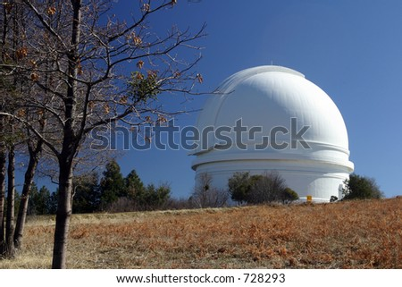 White dome of the astronomical observatory on the top of a mountain - stock photo