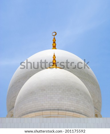 White domes of mosque with golden spiers over the blue sky. Abu-Dhabi, UAE - stock photo