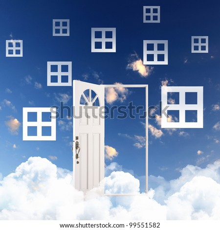 White door against blue sky background