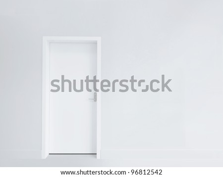 White door and blank wall - stock photo