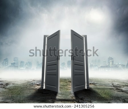 White door on dark city background - stock photo