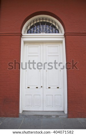 White door, red building in New Orleans, Louisiana, USA