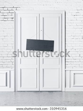 white door with an empty plate - stock photo