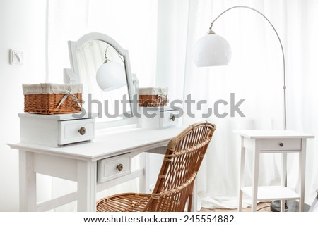 White dressing table with wicker elements, horizontal - stock photo