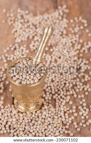 white, dry  pepper on a wooden background